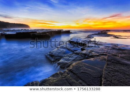 Ocean flows around the rocks at Bungan Beach Stock photo © lovleah