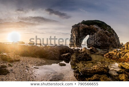 Zonsondergang saffier kust vingers rotsen uit Stockfoto © lovleah