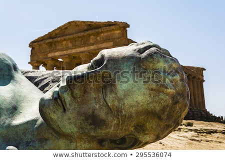 Concordia Temple behind the bronze Icarus sculpture - Valley of temples Stock photo © ankarb