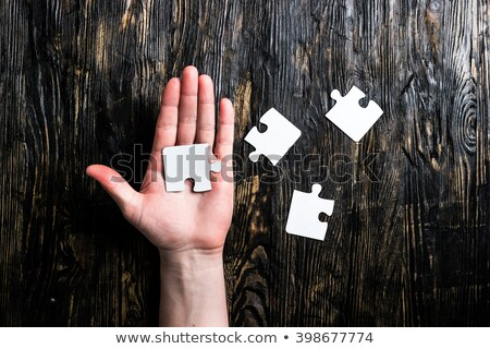Blank jigsaw puzzle on wooden table Stock photo © stevanovicigor