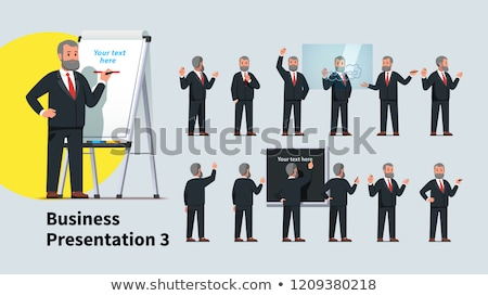 Businessman With Marker in Front of the Flipchart stock photo © Voysla
