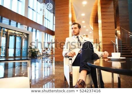 красивый мужчина лобби роскошь телефон счастливым Сток-фото © konradbak