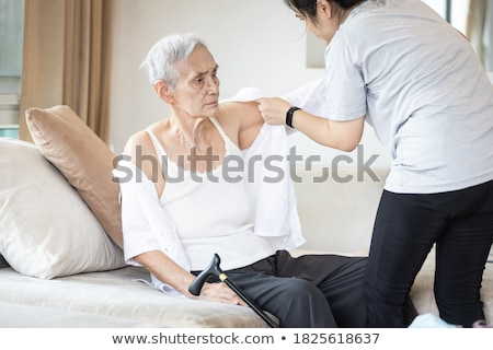Woman undressing at home Stock photo © deandrobot