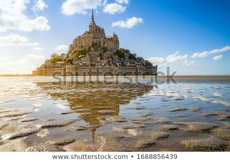 Mont Saint-Michel with clouds at a sunny day, Normandy, France Stock photo © fisfra