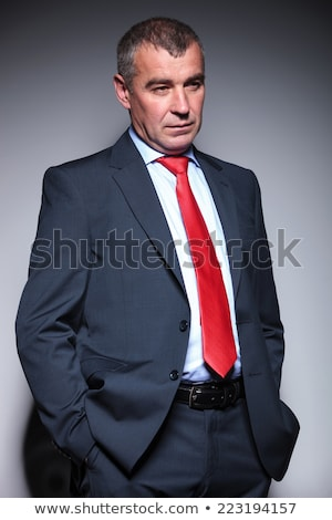 Handsome senior adult male with hands in pockets Stock photo © ozgur