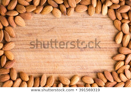 Rectangular border or frame of fresh almonds Stock photo © ozgur
