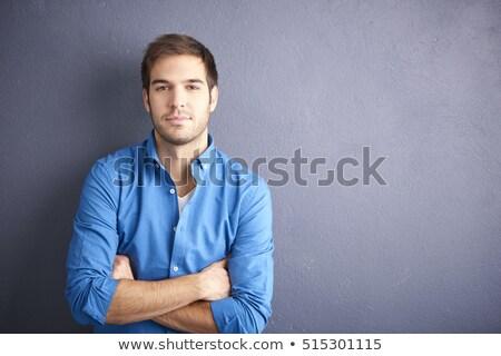 Bello sorridere barbuto uomo piedi braccia incrociate Foto d'archivio © deandrobot