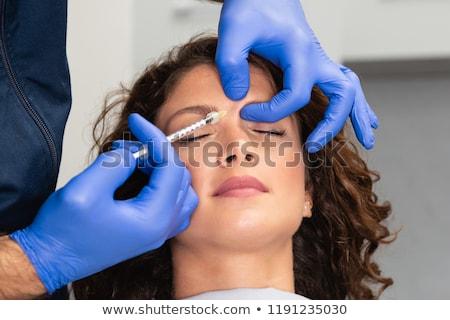mulher · injeção · sobrancelha · tratamento · cara · elevador - foto stock © zurijeta