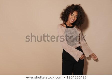 csinos · nő · bézs · nadrág · izolált · fehér · lány - stock fotó © Elnur