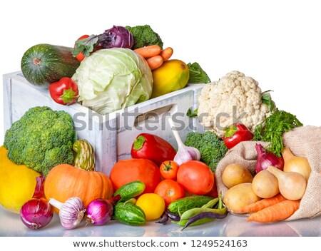 Pumpkins and carrots for sale Stock photo © elxeneize