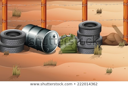 Wheels and fuel containers near the barbwire fence Stock photo © bluering
