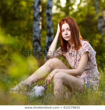 Redhead girl walking under sunset rays in forest stock photo © mrakor