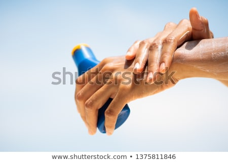 Sunscreen sun lotion bottle on beach vacation Stock photo © Maridav