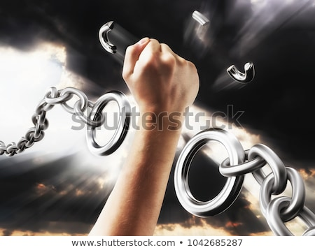 Foto d'archivio: Fist On Chain Breaking Link - Liberation And Freedom Concept