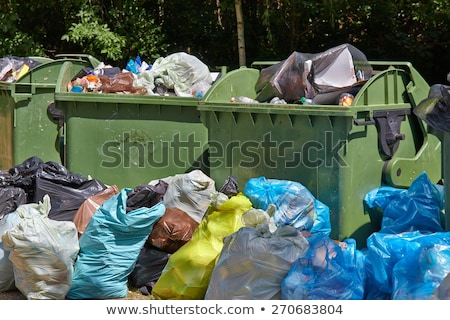 Trashcan and bags full of waste Stock photo © bluering