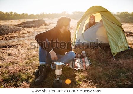 Junger Mann Kaffee Freundin Zelt Stock foto © deandrobot