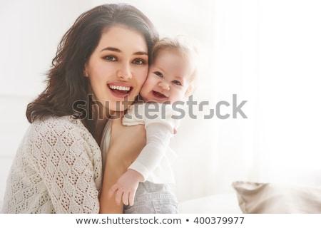 Boldog anya baba kanapé ölelkezés gyermek Stock fotó © deandrobot