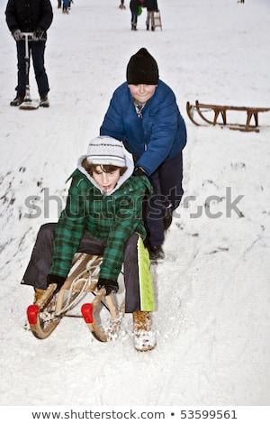 children are skating at a toboggan run in winter on snow Stock photo © meinzahn