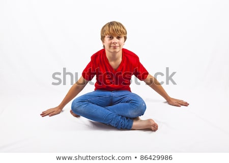 smart boy with red shirt sitting in tailor seat at the floor stock photo © meinzahn