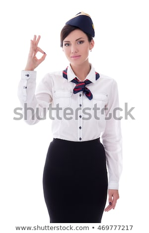 Smiling stewardess showing ok sign. Stock photo © RAStudio