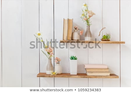 Edad libros flores mujer flores blancas Foto stock © neirfy