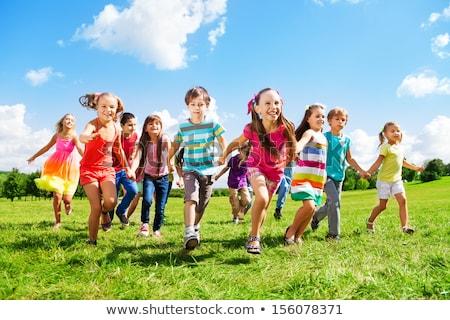 jongens · meisjes · spelen · park · grappig · cartoon - stockfoto © nikodzhi