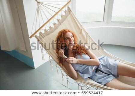 cute · weiblichen · Sitzung · Hängematte · Bild - stock foto © deandrobot