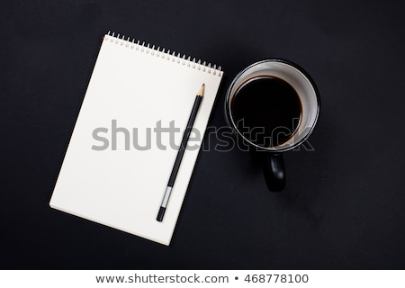 Stok fotoğraf: White Paper Notepad And A Cup Of Coffee On Black Chalkboard Back