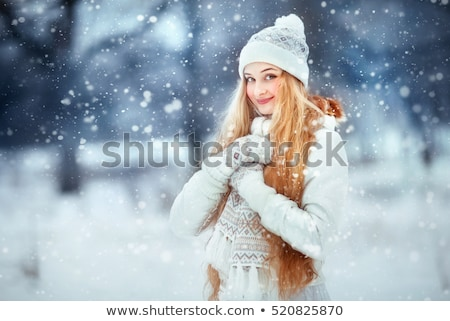 Young woman in winter clothes standing under the snow stock photo © dariazu