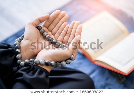 Asian Muslim woman studying Koran or Quran Stock photo © Kzenon