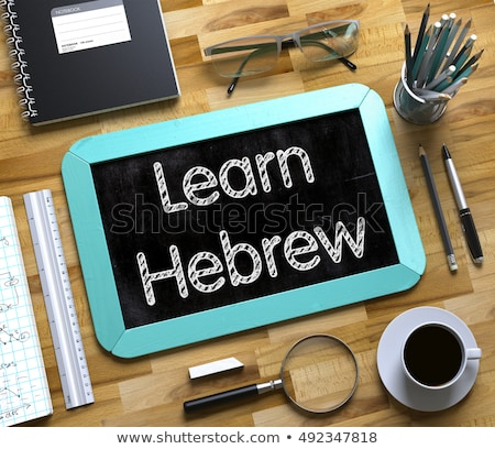 Learn Hebrew Concept on Small Chalkboard. 3D Stock photo © tashatuvango