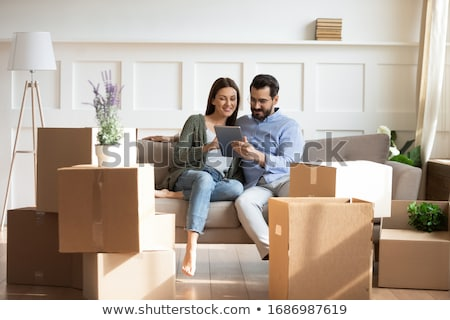 full length image of two smiling women hugging with packages stock photo © deandrobot