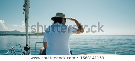 Fiú ül íj jacht utazás jókedv Stock fotó © IS2