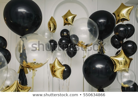 happy woman in dress with helium air balloons Stock photo © dolgachov