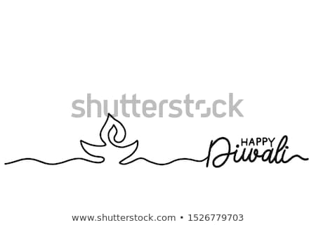 Stock photo: Diwali oil lamp with hands