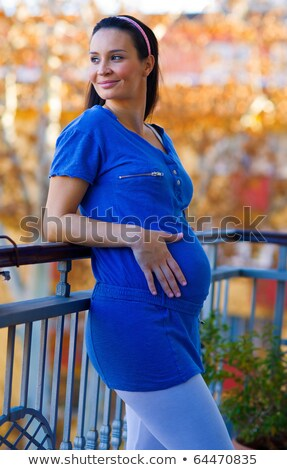 pregnant woman on balcony Stock photo © IS2