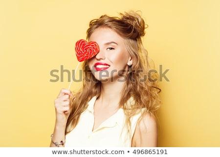 Souriant femme blonde tenir portrait rayé Photo stock © Traimak