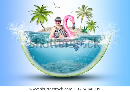 man with a pink flamingo swim ring Stock photo © nito