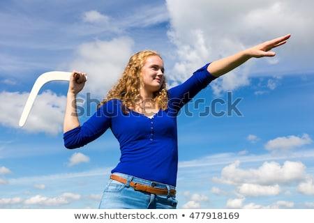 Lány dob bumeráng nő tengerpart nyár Stock fotó © IS2