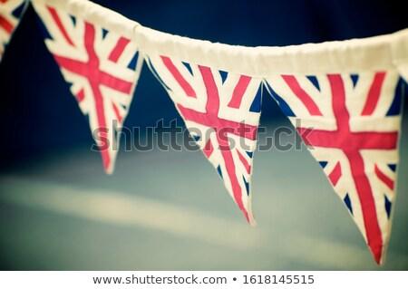 Brit zászló zászlók akasztás London városi busz Stock fotó © IS2