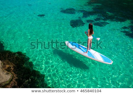 woman standing on a beach with a raft stock photo © is2