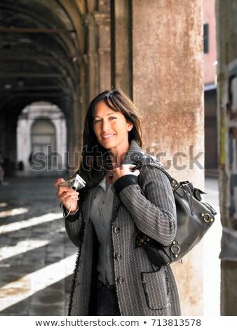 Woman holding digital camera. Venice Stock photo © IS2
