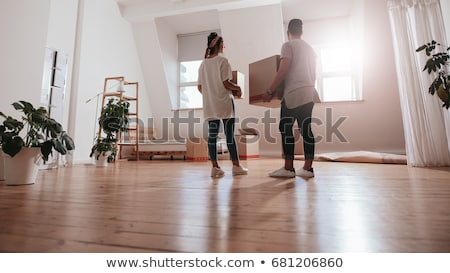 Couple moving boxes into empty house. Stock photo © IS2