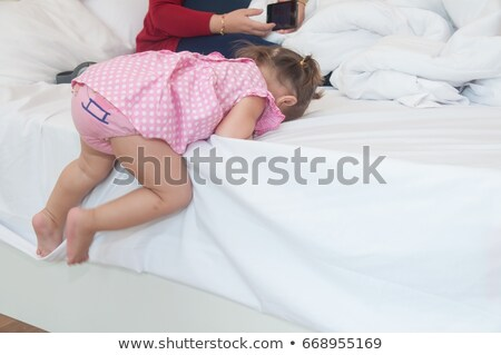little girl climbing pink stairs of slide Stock photo © lunamarina