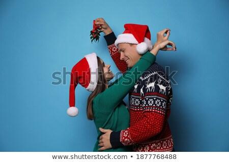 Frau stehen Haufen Mistel weiß Party Stock foto © monkey_business