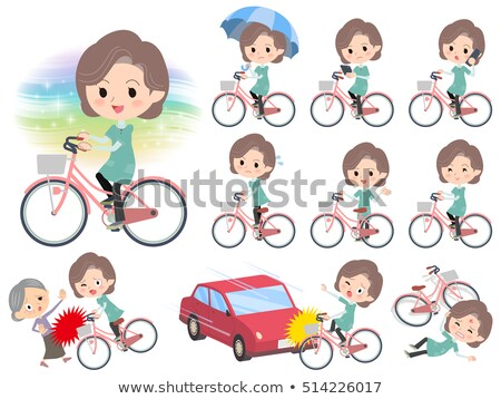 Blue-green tunic Middle woman ride on city bicycle Stock photo © toyotoyo