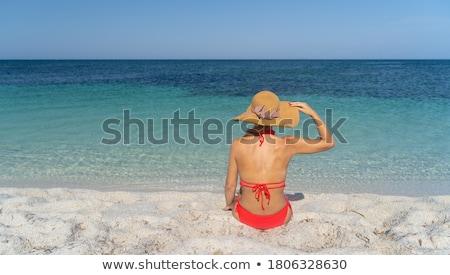 happy woman in sun hat tanning on bora bora beach Stock photo © dolgachov