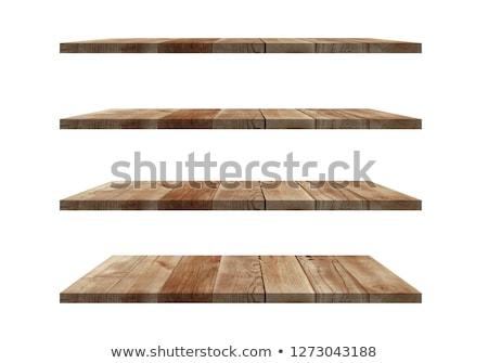 Empty wooden shelve in front of wooden wall Stock photo © karandaev