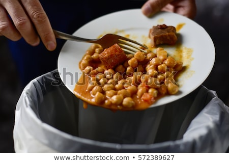 Man Refusing Friend Food On Plate Stock photo © AndreyPopov