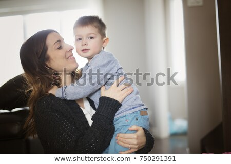mother and son having good time in livingroom stock photo © Lopolo